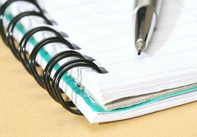 closeup of a notebook and pencil